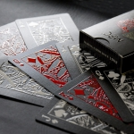 IMPRESSIONS CARDINAL Playing Cards. Snow and blood on black with a striking embossing